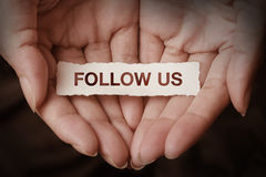 Follow us. Text on hand Royalty Free Stock Photos