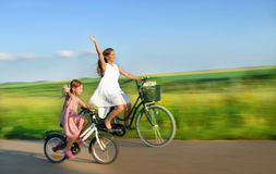 Follow the wind. Family spend time together,   they bicycling Royalty Free Stock Photo