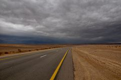 Follow the yellow line road. Israeli negev road at winter weather, grey version Stock Image