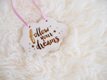 Follow your Dream sign Cloud on White furry Fantasy background. Inspiration Quote Stock Photos