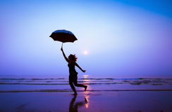 Follow your dream. Follow the dream, woman with umbrella royalty free stock photos