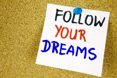 Follow your dreams on color sticker notes over cork board background. Businnes concept Royalty Free Stock Photography
