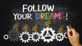Follow your dreams. Concept hand drawn on blackboard stock photos