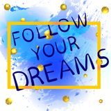 FOLLOW YOUR DREAMS gold gradiend hand written letters on blue paint splash with glittering golden balls. Stock Photography