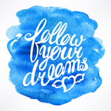 Follow your dreams. Hand-drawn quote on watercolor background Stock Photo