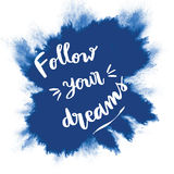 Follow your dreams hand lettering inspirational message. Follow your dreams inspirational message on blue splash background Royalty Free Stock Photography