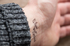 Follow your dreams. Hand with tattoo follow your dreams stock photos