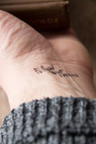 Follow your dreams. Hand with tattoo follow your dreams royalty free stock image
