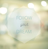 Follow your dreams, Inspirational typographic quote on blur abst Royalty Free Stock Image