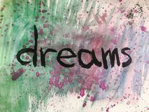 Follow your dreams motivational message over colorful painted background. royalty free stock photos