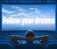 Follow your dreams phrase on screen. Follow your dreams phrase on cinema screen Royalty Free Stock Photos