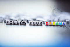 Follow your dreams text made from plastic letter beads Stock Photo