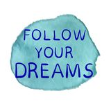 FOLLOW YOUR DREAMS text on paint spot, hand sketched typographic elements. Blue splash and blue inscription Royalty Free Stock Images