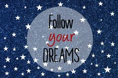 Follow your dreams written over blue glitter background Royalty Free Stock Photography
