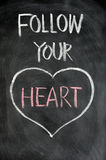 Follow your heart. Drawn in chalk on a blackboard Royalty Free Stock Images