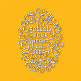 Follow your heart and dream on yellow background Royalty Free Stock Photo