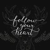Follow your heart, inspirational card Stock Images