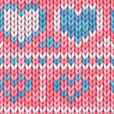 Pink and blue seamless knitted pattern with hearts. Woolen cloth. Knitted Pattern in scandinavian style for greeting card, banner, royalty free stock photo