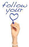 Follow Your Heart. A woman's hand writing Follow Your Heart Royalty Free Stock Image