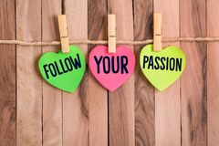 Follow your passion heart shaped note stock photos