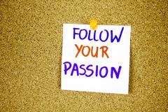 Follow your passion on Sticky note with inscription pinned on a cork bulletin board. Businnes concept Stock Images