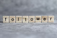 Follower word written on wood cube royalty free stock photography