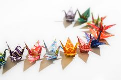 The followers. A queue of origami birds royalty free stock image