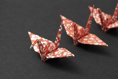 Followers. Three origami cranes on a black ground Stock Images