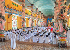 Followers of the Cao Dai praying in Cao Dai Temple Stock Images