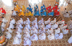 Followers of the Cao Dai praying in Cao Dai Temple Royalty Free Stock Photo