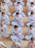 Followers of the Cao Dai praying in Cao Dai Temple Stock Photos