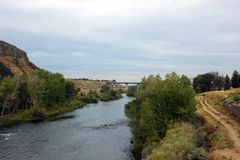Following the Boise River. Plants, a bridge, and cliffs around the Boise River stock image