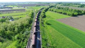 Cargo train. Following the cargo train and wagons by drone. Novi Sad, Serbia stock video footage