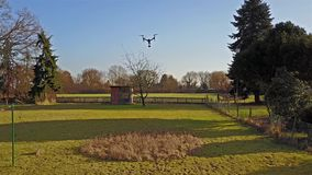 Following the flying multicopter stock video footage