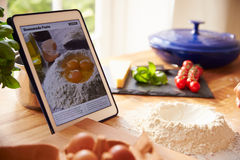Following Pasta Recipe Using App On Digital Tablet Stock Photography