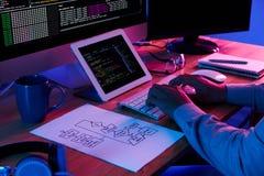 Following plan. Developer following scheme he has drawn when wring a code Royalty Free Stock Photo