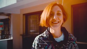 Following red haired attractive hipster young woman back slow Motion 4K . Fashionable footage stock video footage