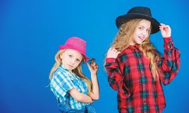 Following sister in everything. Girls kids wear fashionable hats. Small fashionista. Cool cutie fashionable outfit. Happy childhood. Kids fashion concept royalty free stock images