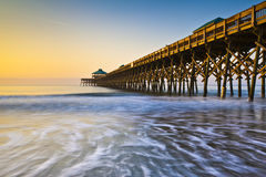 Folly Beach Pier Charleston SC Atlantic Coast. Folly Beach Pier Charleston SC Coast Atlantic Ocean Pastel Sunrise vacation destination scenics Royalty Free Stock Photography