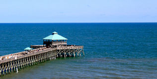 Folly Beach- Pier in SC. Folly Beach pier on the left side of image in South Carolina stock images