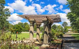 Folly or pavillion with rough facsimile of classical columns and wooden beams in an autumn park stock photography