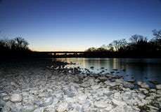 Folsom River Bridge at Sunset. Folsom River at sunset, with glittering water in a natural background Stock Image