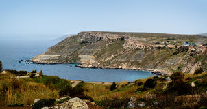 Fomm ir-Rih coast and bay in North of Malta. Northern Coast with cliffs and bay near Fomm ir-Rih, Malta Stock Photo