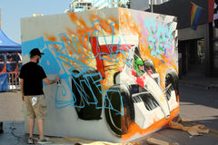 Fomula One Painter. A man painting a display for formula one in Austin, TX at the Fan Fest Royalty Free Stock Photography