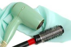 Fon e hairbrush fotografia stock