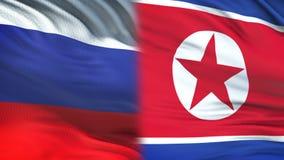 Fonctionnaires de la Russie et de la Corée du Nord échangeant l'enveloppe confidentielle, contre des drapeaux clips vidéos