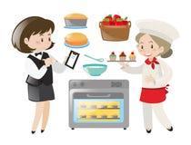 Fonctionnement de chef et de serveuse Photo stock