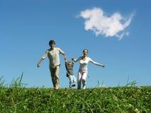 Fonctionnement de famille Photographie stock libre de droits