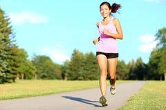 Fonctionnement de femme de forme physique de sport Photo stock