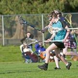 Fonctionnement de joueur de Lacrosse des femmes Image libre de droits